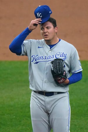 Kansas City Royals starting pitcher Brad Keller adjusts his cap during the first inning of Thursday's game against the Chicago White Sox in Chicago. Keller, after the shortest opening day outing in franchise history, struggled again, allowing four runs in 3 1/3 innings in a 6-0 loss.