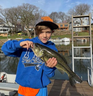 The author's grandson, Grady, caught this nice bass on a 1/32-ounce crappie jig. Light tackle can be effective for early spring bass fishing.