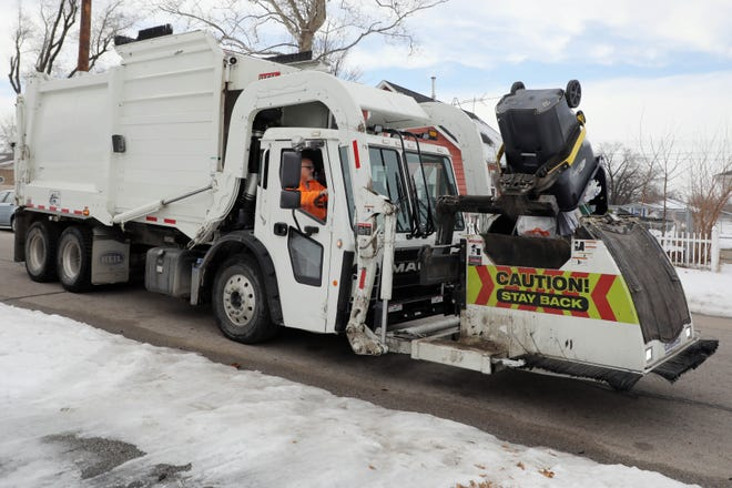 City worker Kelly Claeys picks up garbage on his route Jan. 14 in Burlington. Burlington's solid waste crews will again conduct their spring cleanup April 19 through May 21.