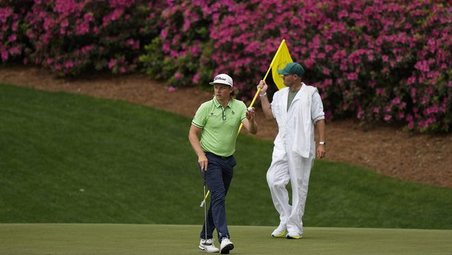 Cameron Smith, of Australia, waves after an eagle on the 13th hole during the second round of the Masters golf tournament on Friday, April 9, 2021, in Augusta, Ga. (AP Photo/David J. Phillip)