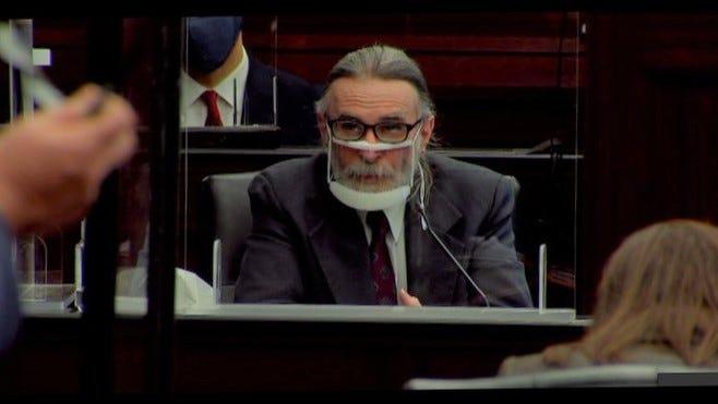 Russell Tillis testifies in court Thursday wearing a transparent face shield.