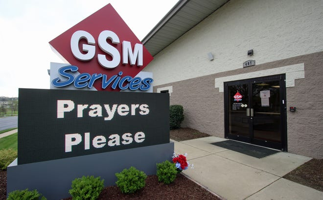 The sign outside Gaston Sheet Metal Services on Long Avenue ask for prayer after two of their employees were shot, killing one, Wednesday afternoon in a shooting near Rock Hill.