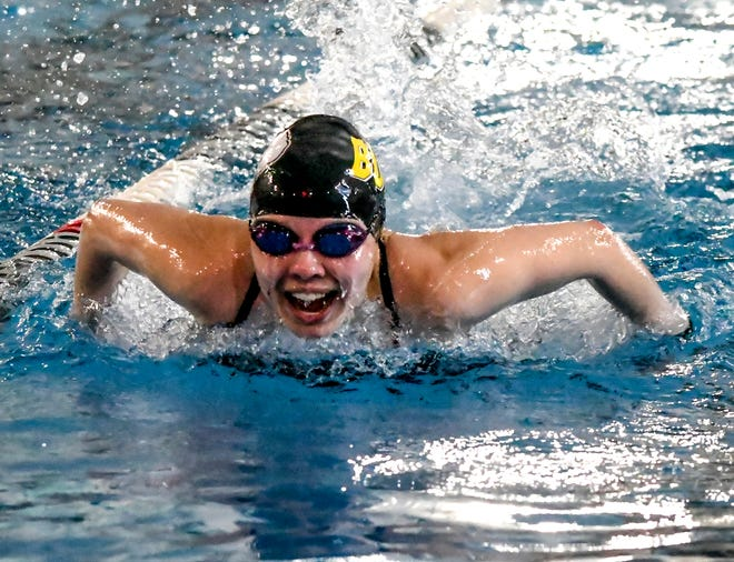 Garden City High School's Mya Garcia comes up for a breath and stroke while competing in a leg of a 200-yard medley relay race April 2 during a home swimming meet at the Garden City Family YMCA.