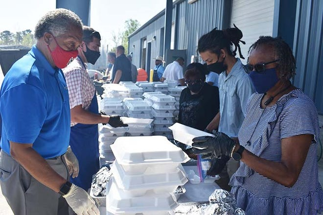 Jacksonville's Neighborhood Improvement Services Advisory Committee with the help of some city staff prepared 200 meals for a recent appreciation lunch. The grab-and-go cookout was held as a 'thank you' to all employees who work in the heat to keep city services running, including sanitation, streets, recreation, parks, and others.