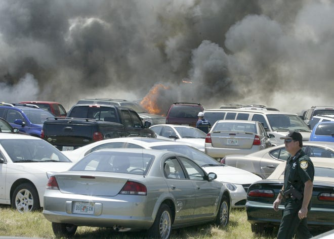 There were 24 car damaged after a fire started under a 2005 Maserati owned by Jim Elliot, of Tarpon Springs, at the 2006 Sun 'N Fun in Lakeland, Fl. Dry conditions and long grass contributed to the fire. No one was injured .FILE PHOTO