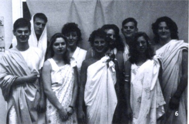 Pictures of the Past is from the 1992 Lincoln Community High School yearbook. It shows students participating in Spirit Week. Students in the photo include: Nathan Horn, Ryan Thomas, Amy Goff, Christina Bosse, Beth Cosgrove, Mindy Withers, Matt Grieme, Heather McGee and Michael Block who are smiling on Toga Day.