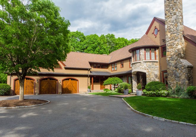 A local custom home builder and his wife have closed on 16 Driftwood Lane in Weston, former home of retired Red Sox star David Ortiz.