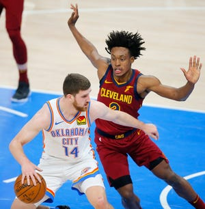 Oklahoma City's Svi Mykhailiuk (14) tries to get past Cleveland's Collin Sexton (2) during an NBA basketball game between the Oklahoma City Thunder and the Cleveland Cavaliers at Chesapeake Energy Arena in Oklahoma City, Thursday, April 8, 2021. [Bryan Terry/The Oklahoman]