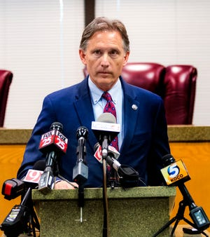 Oklahoma Attorney General Mike Hunter addresses the media in this July 2019 file photo taken in Norman.