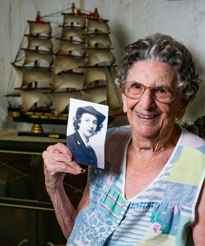 Harriet Dalton, 96 holds a portrait of herself when she was 20 years old and serving as a Navy seaman first class with the WAVES (Women Accepted for Voluntary Emergency) during World War II.