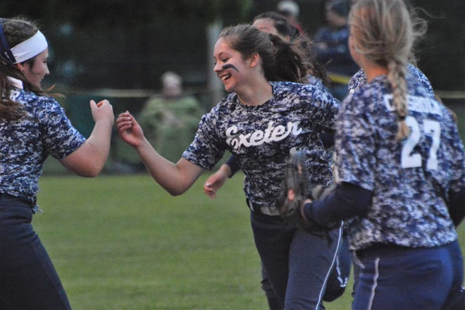 Exeter's Julia Sveen, center, celebrates with teammates after making a fine defensive play during the 2019 D-I semifinals, a 7-0 win over Concord. Sveen is one of two starters returning for the Blue Hawks in 2021.