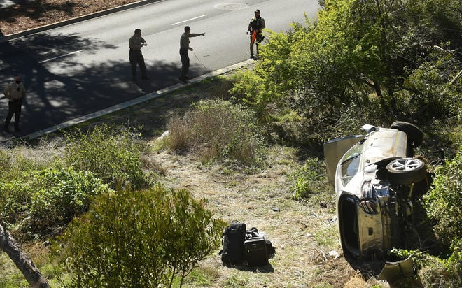 L.A. County Sheriff's officers investigate a one-vehicle accident involving Tiger Woods in Rancho Palos Verdes, California on Feb. 23.