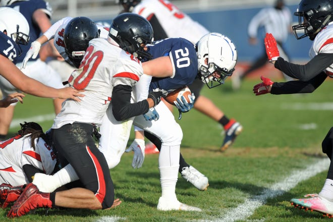 Westerly's Aaron Perez (shown in last week's game against Rogers) scored two touchdowns against Mt. Hope Friday night, helping the Bulldogs clinch one of the two spots in the Division II-B playoffs.