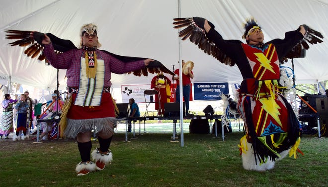 Two dancers from the Sahawe Indian dancers perform at Ballinger's Ethnic Festival in 2019.