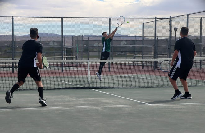 Ryan Coppersmith desperately reaches to get his racquet on the ball during the Burros match against Hesperia's No. 1 doubles team Wednesday.