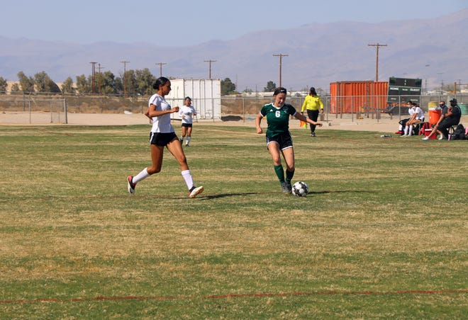 A Lady Burro moves the ball downfield in an effort to create a scoring opportunity during Wednesday afternoon's game.