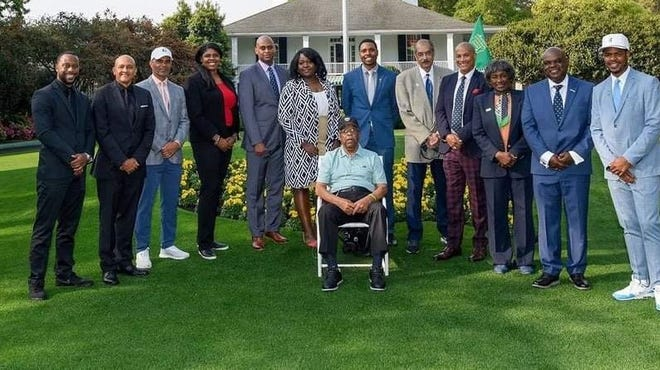 Northern Ohio PGA member Renee Powell, third from left, represented Black PGA professionals at the Masters kick-off. She is pictured with Lee Elder, seated, and other PGA professionals.