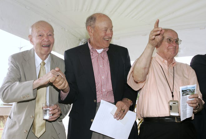 The Nicholas brothers — (from left) Bill, Ab and Dan —stand to be recognized during an Aug. 4, 2009, groundbreaking ceremony for the Nicholas Conservatory and Gardens in Rockford.