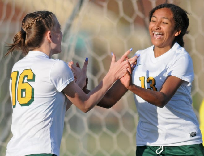 Salina South forward Brooklynn Needham (16) celebrates with teammate Anahyssa Nash (13) after assisting on Nash's first-half goal during the Cougars' 3-0 victory over rival Salina Central on Thursday night at Salina Stadium.
