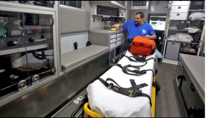 David Martin prepares his bag in the back of an amulance at Shelby Rescue Squad. File photo by Brittany Randolph / The Star]