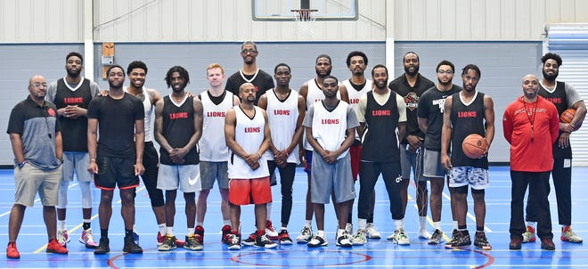Meet the Lions team (left to right) owner Marcus Tilghman, a Sarasota native, Booker High School graduate, and former Tornado assistant girls basketball coach, D.J. Laster, 24, Jamal Gaines, 26, Malcolm Mabry, 24, Brachon Griffin, 28, Blake Morrow, 24, Isaac Freeman, 28, Tyc Snow, 36, Damian Young, 24, Sed Casimir, 25, Myron Hagins, 23, R.J. Palmer, 24, Ken Lewis, 27, Quantel Denson, 28, Eric Davis Jr., 23, Quennel Francis, 28, Emilio Parks, 29, and (in red shirt) general manager Martin Benders   Photographed Wednesday, April 7, 2021.