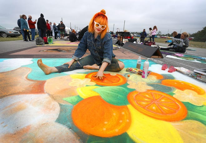 """As the city of Venice looks to start issuing permits for larger events, plans for the 2021 Chalk Festival are underway, too. Shown here, chalk artist Macy Higgins of Tampa works on her entry for the Sarasota Chalk Festival, """"Garden of Wonders – A tribute to the marvels of the natural world and the human imagination,"""" at the Venice Airport Fairgrounds in 2019."""
