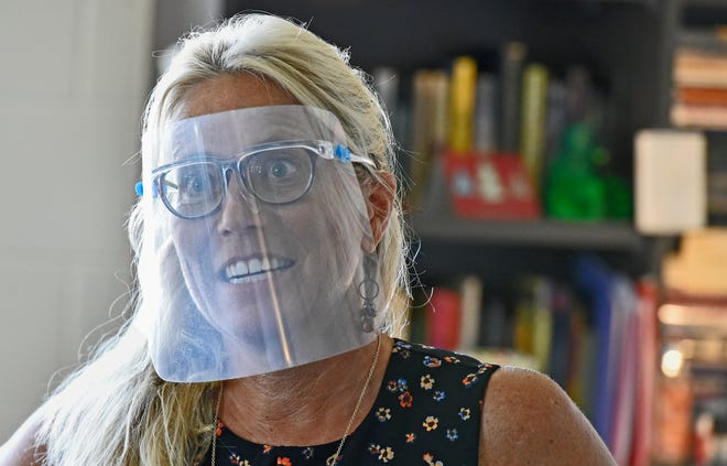 Booker High School English teacher Rebecca Prozzo dons a face shield. In Sarasota County, seven staff members tested positive for COVID-19 this week, the lowest number of positives since October.Manatee Schools had no staff test positivefor the week as of Friday morning, the first time that has happened this school year.