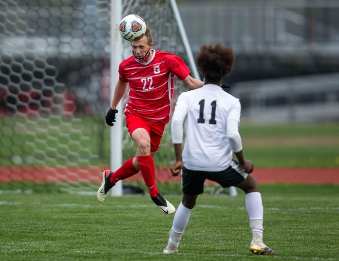 Glenwood's Caleb Steber (22) smacks a header against Sacred Heart-Griffin's JJ Munuo (11) in the second half at Glenwood High School in Chatham, Ill., Thursday, April 8, 2021. [Justin L. Fowler/The State Journal-Register]