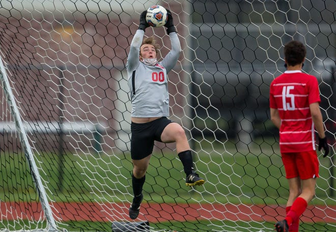 Chatham Glenwood goalkeeper Will Lieber (00) makes a save in front of the net against Sacred Heart-Griffin in the second half at the Glenwood Athletic Complex on Thursday, April 8. [Justin L. Fowler/The State Journal-Register]