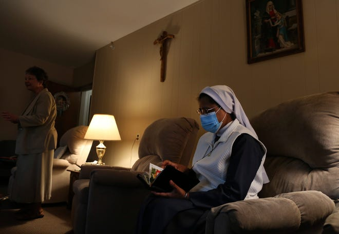 Sister Rose Nellivila sits for morning prayer at St. Anne Home in Greensburg, Pa., where she serves as a nurse for residents of the nursing facility, on Thursday, March 25, 2021. Nellivila contracted the coronavirus last fall and made a full recovery, but a fellow nun, Sister Mary Evelyn Labik, died in October. (AP Photo/Jessie Wardarski)