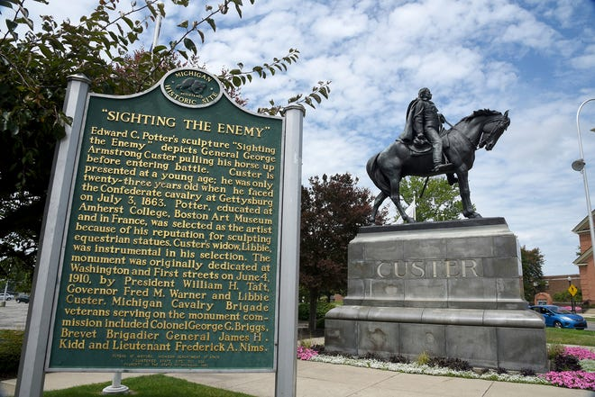 FILE- In a July 22, 2020 file photo, a Gen. George Custer statue is seen in downtown Monroe, Mich. The city wants to hire an expert to try to reach a community consensus over the future of a monument dedicated to Custer. The general, who lived in Monroe, has long been recognized as a heroic Army officer, first during the Civil War. But critics note that he also went to war against Native Americans before dying at the Battle of the Little Bighorn in 1876. (AP Photo/The Monroe News, Tom Hawley)