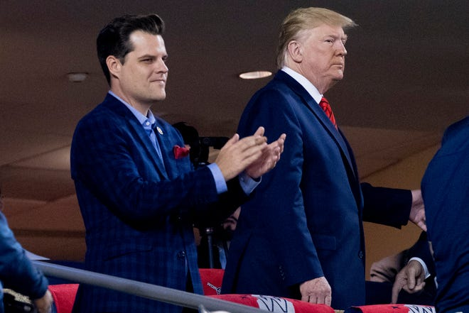 President Donald Trump, right, accompanied by Rep. Matt Gaetz, R-Fla., arrive for Game 5 of the World Series baseball game between the Houston Astros and the Washington Nationals on Oct. 27, 2019, at Nationals Park in Washington.