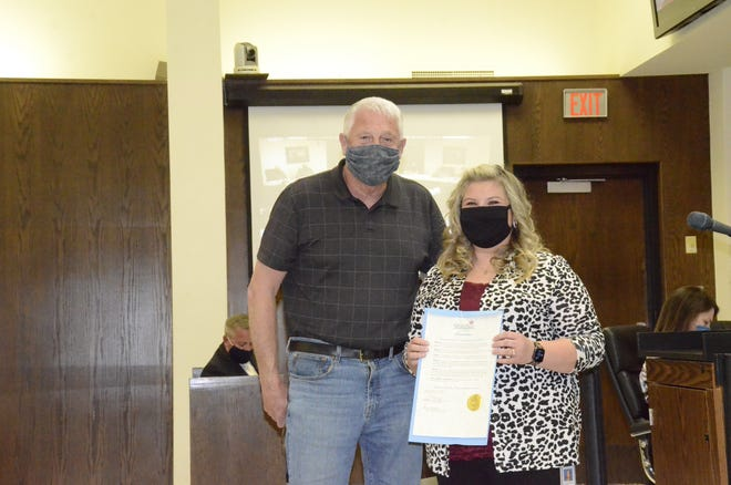 Mayor Ed Bolt, left, is shown with Christina Brown, communications manager for Shawnee Dispatch, just after he proclaimed April 11-17 is National Public Safety Telecommunications Week.