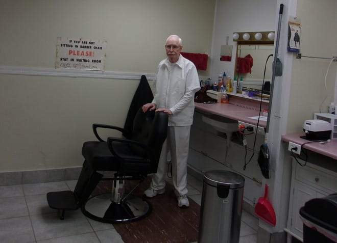 Jimmy Johnson has run his Milton barber shop for more than 50 years.