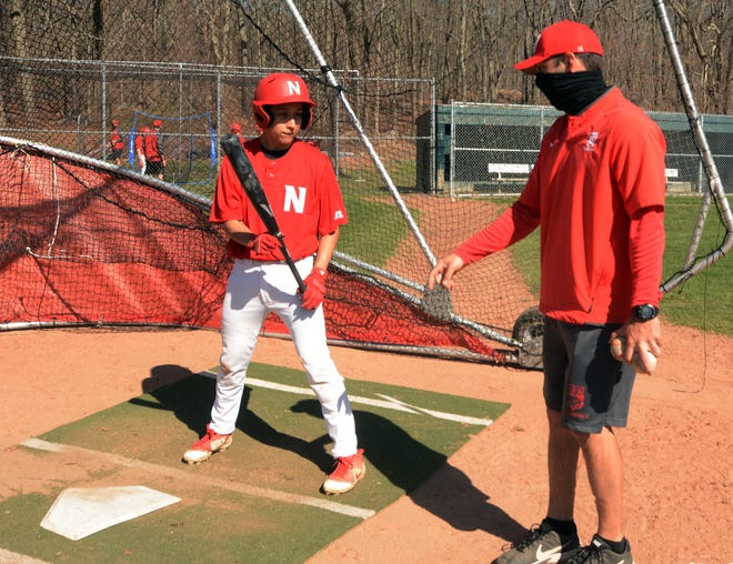 NFA baseball coach Anthony Turgeon and senior Anthony Sanchez get ready for the 2021 season at Dickeman Field in Norwich.