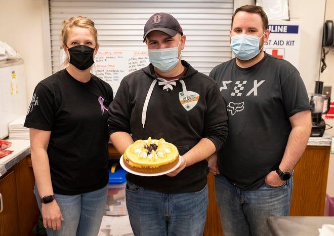 WORCESTER - Shannon Horan, David Silva, owner of Who Cut the Cheesecake, and John Wojcik.