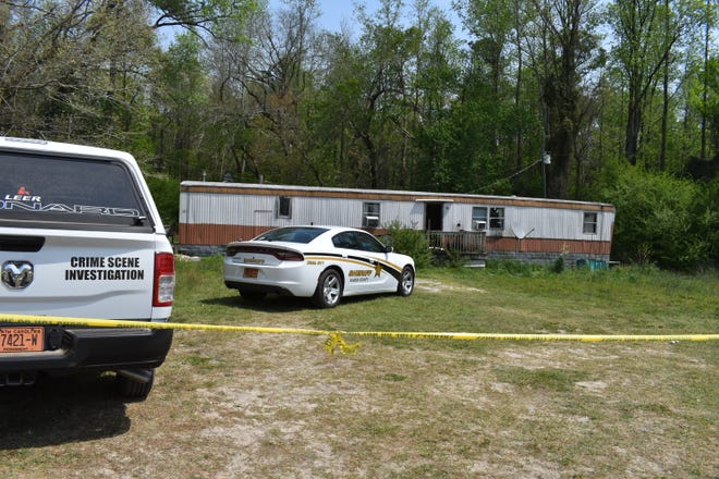 Bladen County officials are trying to determine the identities and cause of death of two people found dead in a home on Cribb Road this week.