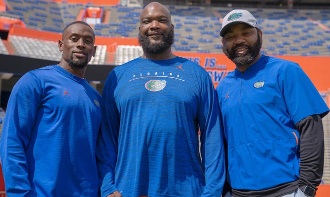Former Florida standouts Vernell Brown, left, Reggie McGrew, center, and Keiwan Ratliff are now helping the next generation of Gators on campus.