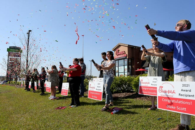 Chick-fil-A in Northport awarded 18 scholarships valued at $2,500 each to workers at the restaurant Tuesday, April 5, 2021. Student employees pop confetti cannons in celebration outside the restaurant. [Staff Photo/Gary Cosby Jr.]