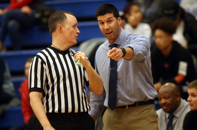 Central Crossing boys basketball coach Neil Hohman discusses a call with an official during a game in January 2020. Hohman recently stepped down after six seasons.