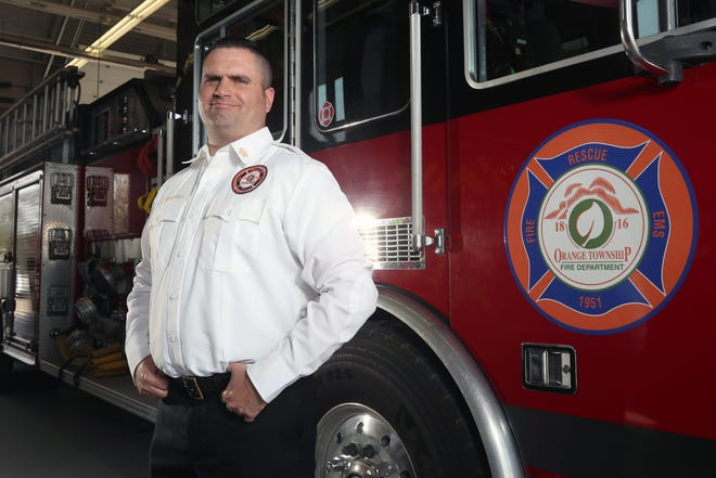 Nathan McNeil, the Orange Township Fire Department's new fire chief, stands in front of a fire truck at the Orange Township Fire Department on April 7.