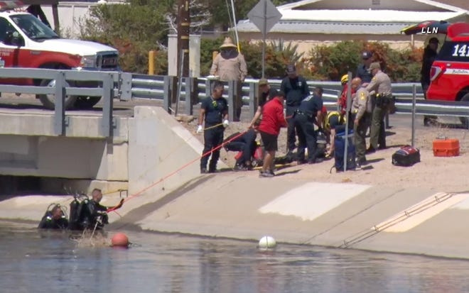 In video, emergency personnel can be seen rescuing a 81-year-old man from the California Aqueduct in Hesperia on Friday, April 9, 2021. The man — later identified as Robert Joseph Caroline — died at the scene.