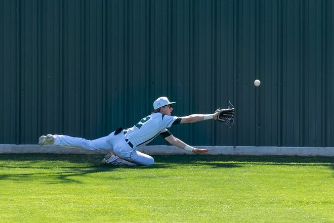 Waxahachie junior outfielder Jared Thomas (2) dives for a line drive during the Robert Dulin Memorial Tournament at Richards Park in March. Thomas homered in the Indians' 9-6 home loss to first-place Waco Midway on Tuesday night.