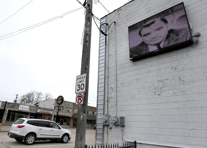 A sign at 200 N. Richmond St. displayed a homophobic slur and images of Joseph McCarthy on Friday in Appleton.