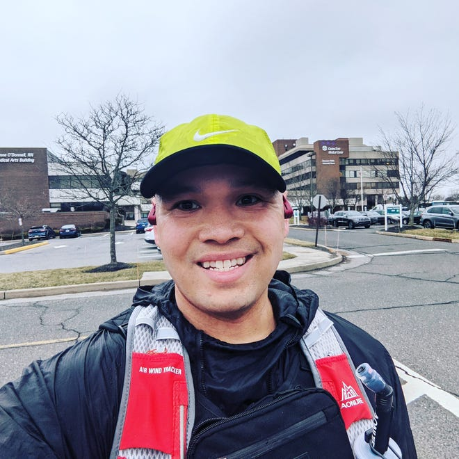 Paulo Santos in front of CentraState Medical Center in Freehold Township, where he was first taken after coming down with COVID-19.