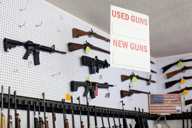 Empty rifle slots tell the story at Leicester Pawn & Gun on April 9, 2021. Between the pandemic, social unrest, a contentious election and talk of gun control, buyers have flocked to stores to buy guns and ammunition.