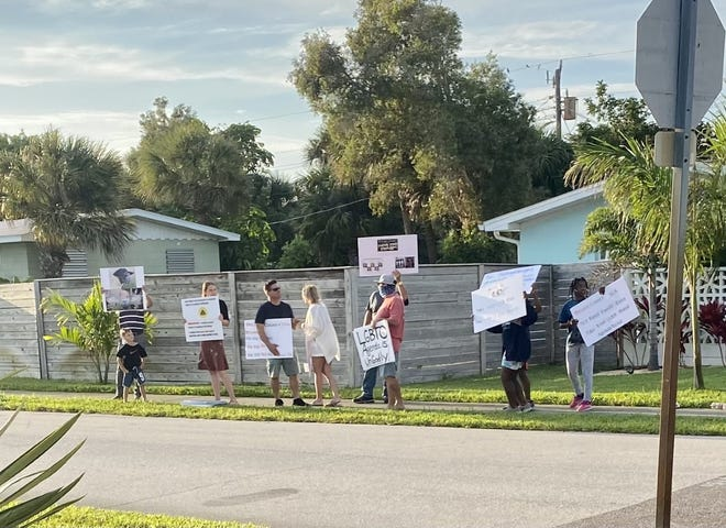Anti-LGBTQ protestors gathered outside the home of Jennifer Jenkins, a Brevard County School Board member who has been supportive of accommodations for LGBTQ students.