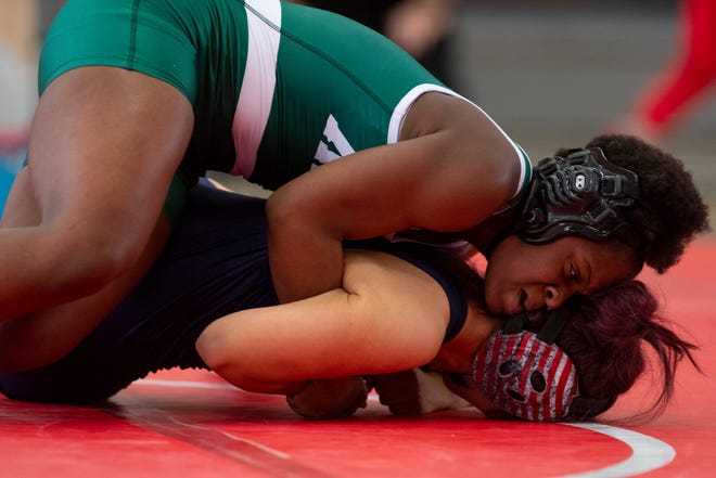 King's Adijah Khamaladeen competes against Veterans Memorial's Brianne Flores during the District 15-5A wrestling meet at Ray High School on Friday, April 9, 2021.
