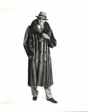 Attorney Elbert Hatchett models a coat from the men's fur salon at Bricker-Tunis Furriers, located West Bloomfield in 1988.