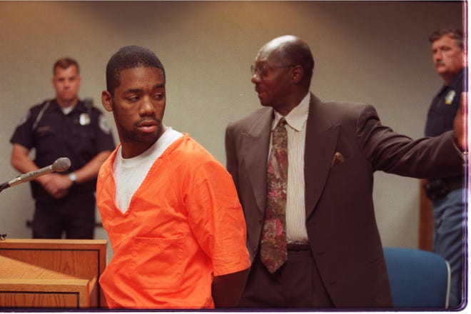Antonio McKelton with his attorney Elbert Hatchett appearing before 48th District Court Judge Gus Cifelli in 1997.  Hatchett commented on the number of police officers posted in the courtroom (at one point there were 10).